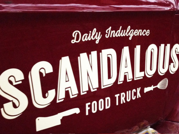 <span>Scandalous Food Truck</span><i>→</i>