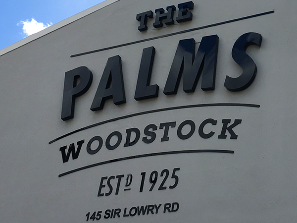 <span>The Palms Woodstock</span><i>→</i>