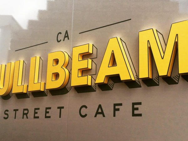 <span>FullBeam Street Cafe</span><i>→</i>