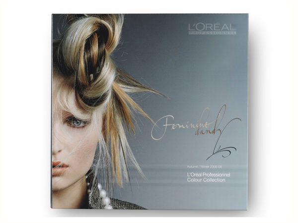 <span>L'Oréal Professionnel</span><i>→</i>