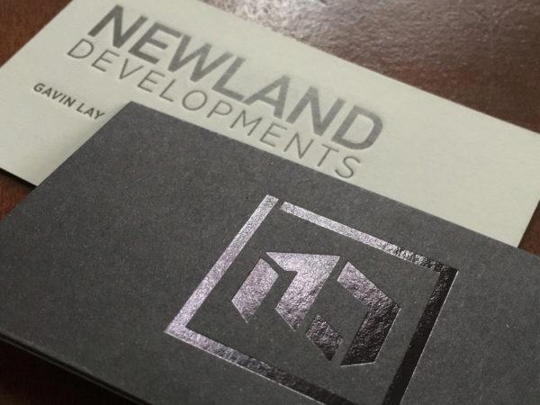 <span>Newland Developments</span><i>→</i>